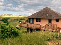 A Deltec circular home surveys its domain in central North Dakota, Great Plains bluffs
