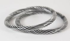 """Lovely pair of vintage glass bangle bracelets probably from India. Black and silver for power and purity, 7 1/4"""" inside diameter and 1/4"""" wide."""