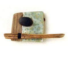 Grace Girvan.  'Lost' brooch in silver, enamel, driftwood, pebble