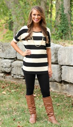 A great transitional tunic for fall. Paired with leggings and our Ashley boots!