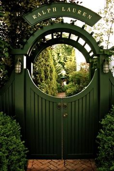 dark green gate and arbor