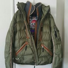 Bogner Sage Ski Parka Mauna Kea Limited Edition Bogner Sage green Ski Parka Puffer. Size 40. Mauna kea Limited Edition. Excellent condition, Brand New. Waterproof & Lightweight. Detachable hood. Inside pockets. Powder skirt to keep from snow from coming up inside your jacket. Excellent for the ski season!! If you BUNDLE 3 items, you get 15% off!  Bogner Jackets & Coats Puffers