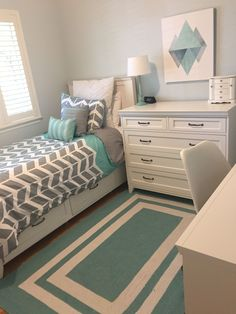 My new bedroom! It's a very small room, but we made it perfect! Grey, teal, and white colour theme.