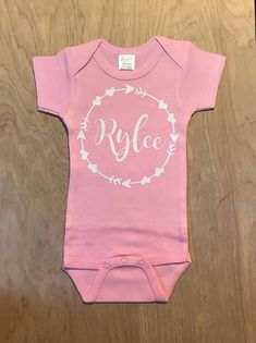 custom baby girl name in arrow-heart circle infant bodysuit baby name bodysuit custom baby bodysuit pregnancy announcement names girl country names girl elegant names girl pretty names girl rare names girl vintage baby names girl Modern Baby Names, Unusual Baby Names, Baby Girl Names, Cute Baby Girl, Baby Baby, Boy Onesie, Baby Bodysuit, Onesie Diy, Baby Outfits