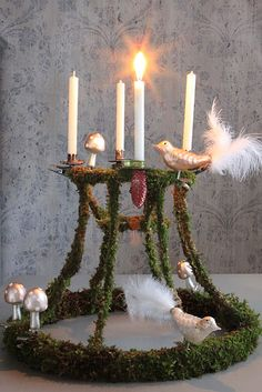 advent wreath made out of a lampshade frame covered with moss ~ ingenious!