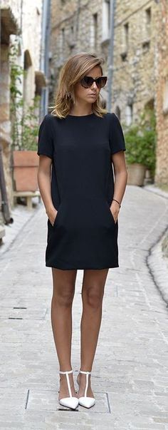 Chic retro little black dress with white heels.