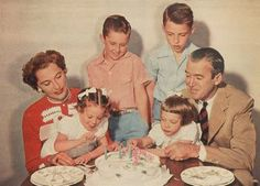 James Stewart, wife Gloria and their four children gather for a birthday party