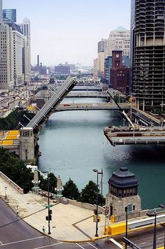 Chicago River-during the summer the bridges go up and down with the sail boats going out to the lake.