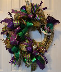 Erasmus Mardi Gras Wreath, Mardi Gras Wreath, Deco Mesh, Mask wreath, Mardi Gras Decor - Deco Mesh over 10 different ribbons used ~ ornaments ~ beads~ Grapvine  wreath spray pinted gold ~ mask with feathers