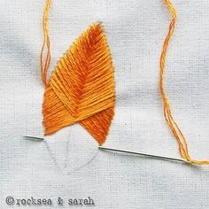 Embroidery Stitches Tutorial Stitch up your own lovely feather patterns with this raised fishbone embroidery stitch tutorial! - Stitch up your own lovely feather patterns with this raised fishbone embroidery stitch tutorial! Embroidery Stitches Tutorial, Ribbon Embroidery, Cross Stitch Embroidery, Embroidery Patterns, Sewing Patterns, Stitching Patterns, Simple Embroidery, Crewel Embroidery, Rose Patterns