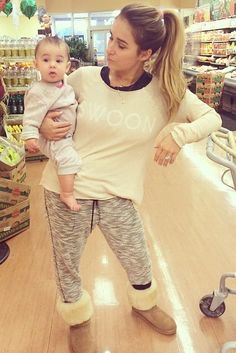 Jessie James Decker wearing Ugg Classic Tall Boots in Chestnut, Forever 21 Marled Knit Joggers and Wildfox Swoon Cozy Raglan