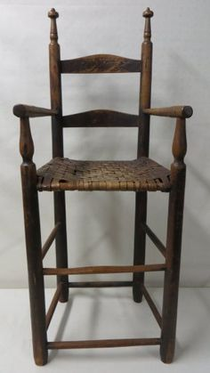 Very fine child's ladder back high chair in original red stain - split cane seat - 18th century.