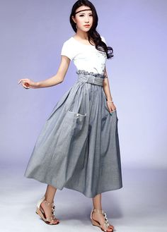 This gray cotton maxi skirt is designed in a A-line silhouette, with Elastic waist , drape big pocket with piping detail, This maxi skirt can be styled