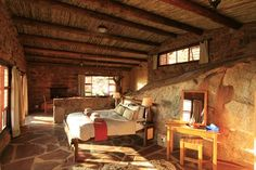 The interior of a bungalow at Eagle's Nest Chalets. Land Of The Brave, Eagle Nest, Main Attraction, Lodges, Bungalow, Safari, National Parks, Castle, Camps