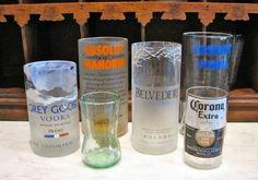 Make candleholders and glasses out of glass bottles-  1. Tie string around bottle just above the label  2. Soak the string in lighter fluid, keeping it tied 3. Put the string back on the bottle. Holding the bottle horizontally light the string and rotate the bottle away from your body  4. Immediately rinse under cold water 5. Sand edges until smooth For candles, add decorative sand or stones Enjoy!