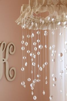 Sparkling, Gorgeous Mobile For Baby Girls Room. Looks easy enough to make. Wire wreath form spray painted white, burlap/fabric, crystals strung onto clear jewelry thread.