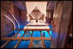 """This bedroom in Bambu Indah resort in Bali must be the ultimate water-bed :) Would you sleep here? We've got a huge collection of bedroom inspiration for you on our """"Bedrooms for Adults"""" album here ---> http://theownerbuildernetwork.co/jw2z"""