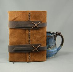 Handmade Leather Journal with Lined by christinemarieford on Etsy, $45.00. Straps sewn on with loose stitches, straps get thinner then thread under the stitches to secure.