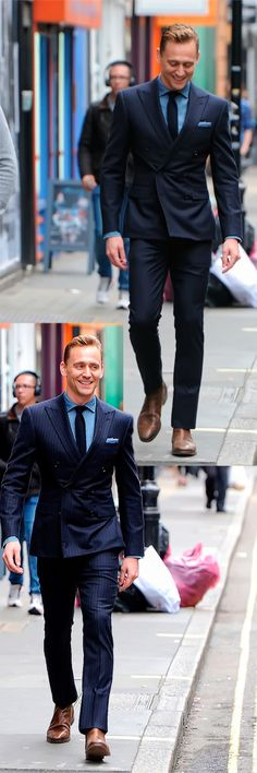 Tom Hiddleston walking down the street like a supermodel