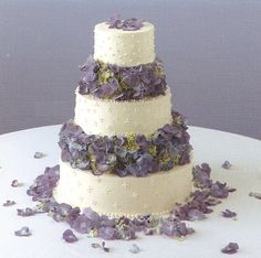 wedding cakes with flowers | Three tier round white icing wedding cake with lots of vivid blue and ...