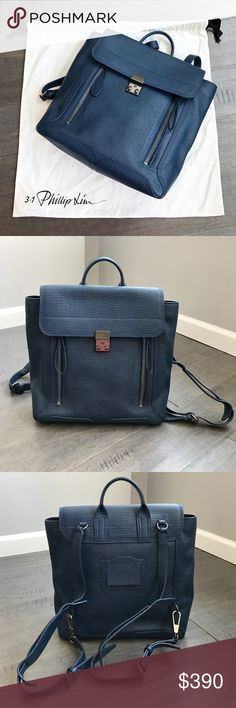 Phillip Lim Pashli textured leather Backpack 3.1 Phillip Lim storm-blue Pashli backpack. Only used a few times- It's in very good condition, like new. Some minor scratches on buckle (shown in picture) NO scratches on leather. There is a stain on the dust bag (shown in picture). 3.1 Phillip Lim Bags Backpacks
