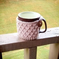 Keep your beverage warm with this knitted mug cozy!