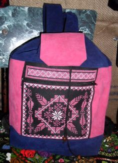 Our medium-sized backpack is perfect for a day trip. This model is pink and blue.