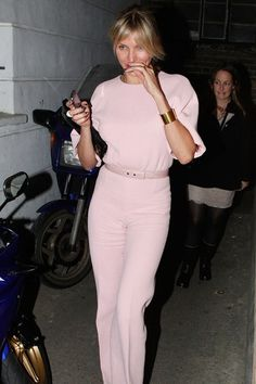 Cameron Diaz wore a pale pink jumpsuit by Emilia Wickstead, accessorised with white peep-toe sandals and a gold cuff, to attend the President Barack Obama fundraiser