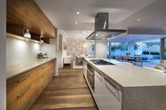 The Etesian by Webb & Brown-Neaves (6) Like the light polished bench tops and mix of wood and white doors