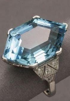 An Art Deco Platinum, Aquamarine and Diamond Ring, Circa 1925. Set to the…