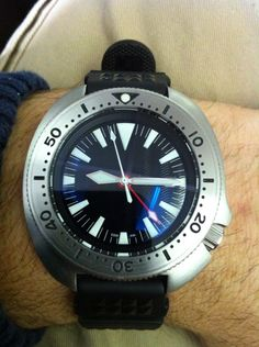Customized and built from junk parts....a vintage Seiko 6105 that now has GMT function (the ability to track a 2nd time zone ) ....notice the 4th hand which rotates once every 24hrs.....this was a labor intensive movement modification that is seldom seen or successfully accomplished