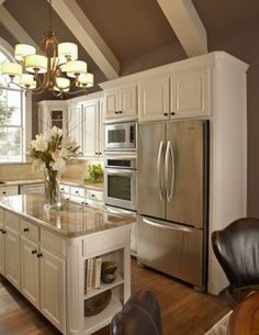 I love white cabnets with stainless steel appliances, but I would want darker countertops and floors