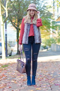 fall style faux fur vest and black ripped jeans How to Style a Faux Fur Vest #Winter #Fall #Outfit #Style
