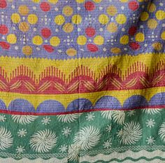 """Couleur Nature designs and produces both """"Provencal-inspired"""" table linens and Indian inspired bedding. (They also sell traditional kanthas handmade in India, as pictured.)"""