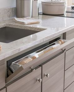 Every nook and cranny of the Maple Ave. kitchen offers a storage solution, like this tilt-down drawer for the kitchen sink. It's a super-convenient place to store odds and ends, like dish sponges and scrub brushes.Shop Martha Stewart Living Kitchens at The Home Depot