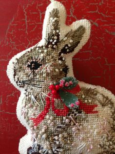 Tutorial on how to hand finish small needlepoint pieces for ornaments. Love this bunny!