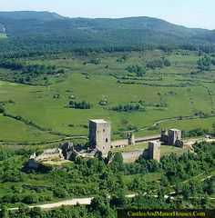 "Castle of Puivert, Aude, Occitanie, France.... www.catharcountry.info ... Before the Albigensian Crusade, the Lord of Puivert belonged to a family with strong Cathar connections. The present structure replaced his ""Cathar Castle"" (the ruins of which are still visible in the left of the structure). In late November 1210 the old castle was taken after three days' siege by crusaders under Simon de Montfort, following the fall of the castles at Termes, Coustaussa and Le Bezu."