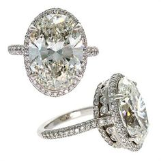 Oval Diamond Ring. I love the basket setting, the style of the thick base is just so pretty on the diamond!