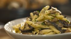 Recipe with video instructions: Mushrooms and pasta make for a magical combination. Ingredients: Salt, 1 ½ cup strascinati pasta, 1 clove garlic, crushed, 1 sprig rosemary, 2 Tbsp butter, 4 large shiitake mushrooms, chopped, ½ pound cremini mushrooms, cho