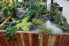 A wonderful miniature garden with a fog water feature and wild animals
