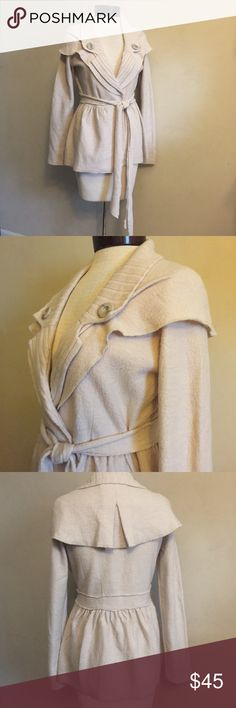 Sparrow Wool Jacket 100% merino wool fabric. It doesn't have buttons closure, just overlaps and tied with belt. Best would fit size 4, but because it can be adjusted by overlapping less, it can fit size 6 too. Very good pre-loved condition. Anthropologie Jackets & Coats