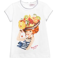Girls fun, white, short-sleeved t-shirt by Monnalisa, with a girl printed on the front wearing a hat decorated with tropical fruits and jewellery embellished with colourful diamantés. The neck and cuffs are trimmed with scalloped navy blue embroidery.