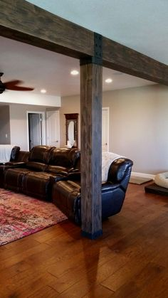 faux beams cover existing support structures in a finished basement, wit. faux beams cover existing support structures in a finished basement, with rubber strapping Basement Remodel Diy, Basement Makeover, Basement Renovations, Home Remodeling, Kitchen Remodeling, Remodeling Companies, Bedroom Remodeling, Attic Renovation, Remodel Bathroom