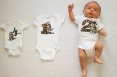 monthly baby photo in wearing a custom Calvin and Hobbes grow with me onesie set