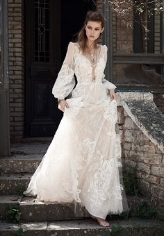 Style BR18 70, Costarellos. V-neck lace wedding dress with bishop sleeve.
