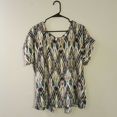 Multi-colored Short Sleeve Blouse fun and colorful short sleeve blouse. Features fully open back with buttons at top and bottom. TUA+ Tops Blouses