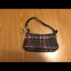 Authentic Plaid Coach Purse This is a beautiful and unique coach purse. It is new with tags. The patent leather on the strap is crocked leather as pictured. It is approximately 8 3/4 inches wide and 5 inches tall. The drop is approximately 7 inches. Any questions just ask! Coach Bags