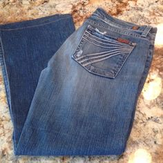 "7 for all Mankind distressed jeans 7 for all Mankind distressed jeans with decorative pockets. Inseam measures 26"" 7 for all Mankind Jeans"