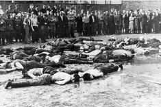 The Lietukis Garage massacre. Crowd views the aftermath of a massacre at Lietukis Garage, where pro-German Lithuanian nationalists killed more than 50 Jewish men. Kovno, Lithuania, June 27, 1941.