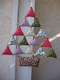 *Hand made Christmas Tree Decoration. *Tree size 14 long each triangle size 2.75 *21 Jingle Bells *This Christmas Tree Decorate Wall, Door, or